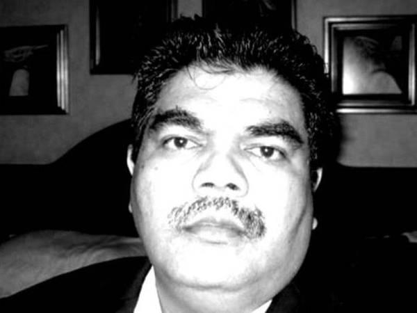 Portrait of Ahmad Kamil Mohamed Tahir. He had short hair, bushy eye brows and a mustache.