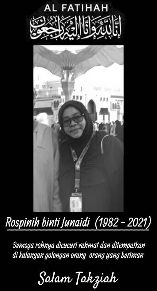 Condolences message for Rospinih binti Junaidi (1982 - 2021). Rospinih is a woman wearing a headscarf, glasses and a lanyard. She is posing in front of Masjid Nabawi in Madinah, Saudi Arabia.