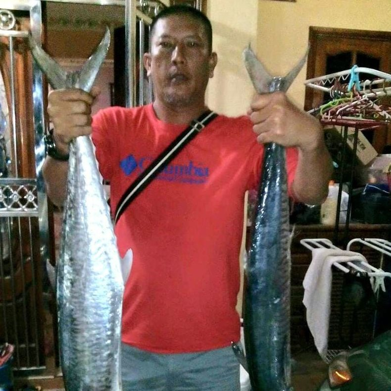 Hasni Kamaludin shows off a pair of fish.