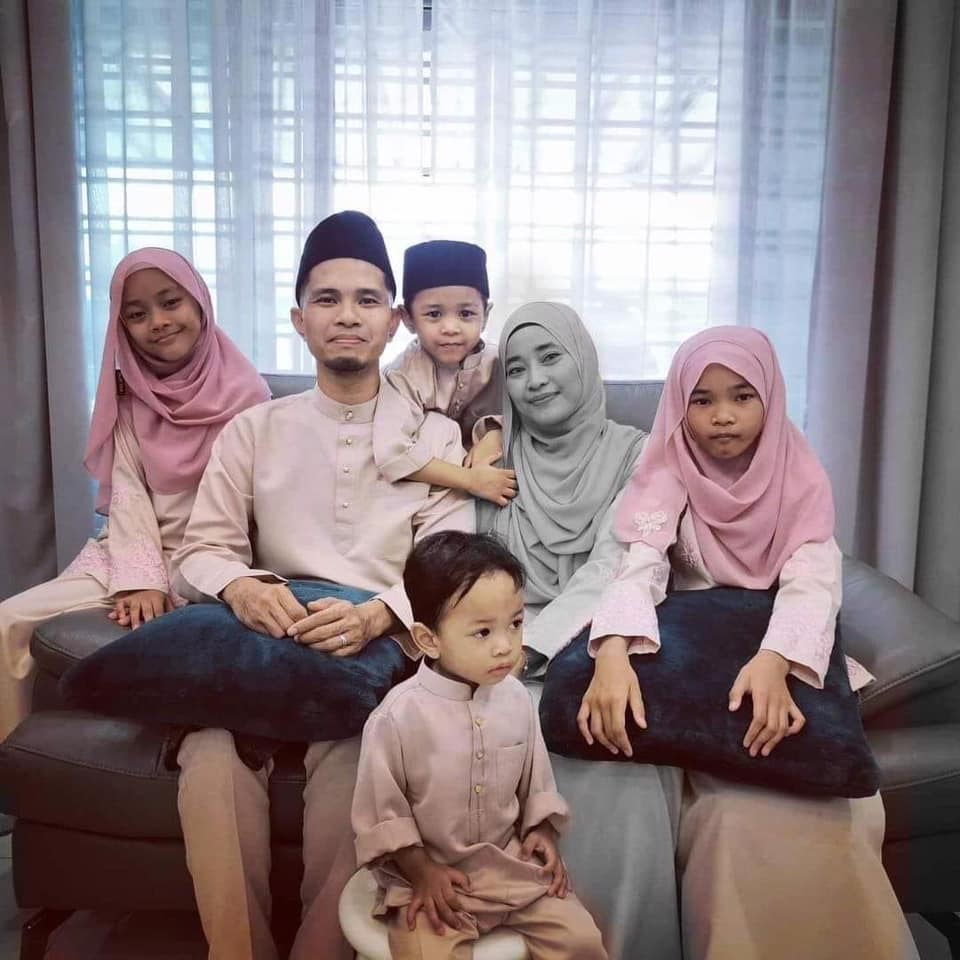 Wardah Faisol with her husband and four young children, two girls and two boys.