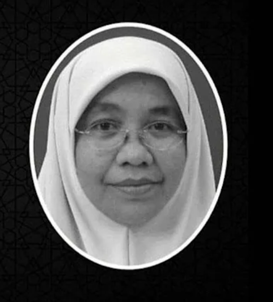 Mariani Sulaiman, 52 - a middle-aged woman in a headscarf and rimless glasses. She is smiling closed mouthed.