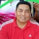 Mohd Azni Johari, donning a red Adidas polo shirt, smiles for the camera.