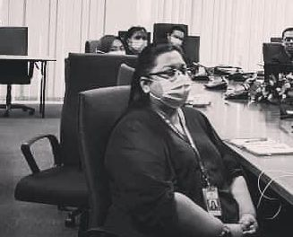 Nirmala Subramaniam attends a meeting. She wears a face mask.