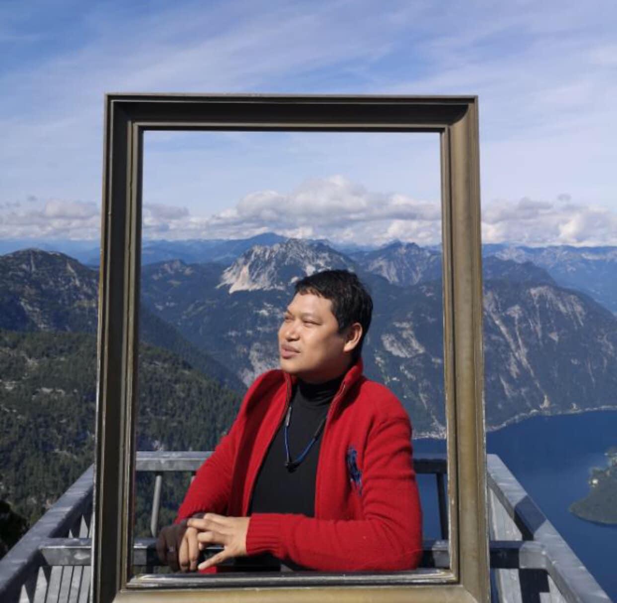 Norfadzi Abdullah takes a photo at a vantage point, during his travels.