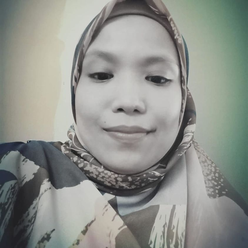 A selfie of Rumeza Zakaria who is pictured smiling, wearing a headscarf