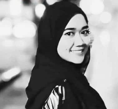 Noor Fazleina Alaeuddin, 33, wears a head scarf and smiles.