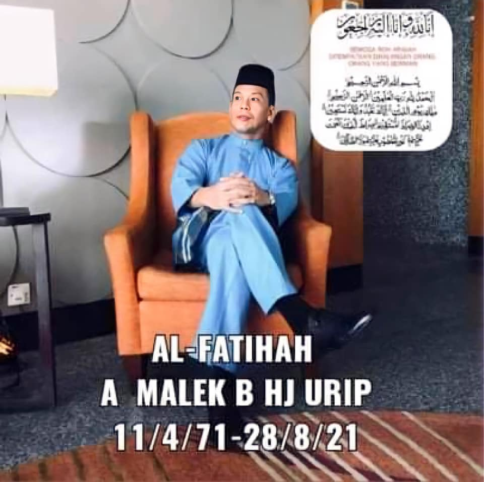 Condolence message for A Malek b Hj Urip who is pictured wearing a blue baju Melayu and songkok, sitting on a brown armchair while looking away from the camera.