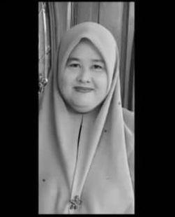 Wan Suzana Wan Daud smiles. She wears a headscarf.
