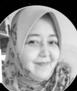 Sufia Abdul Shukor smiling.