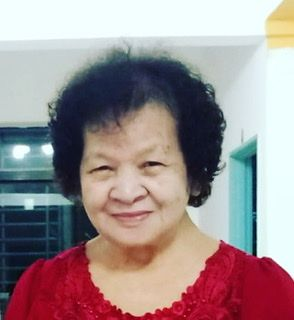 Bong Ngiun Jin is smiling. She has thinning permed, short hair.