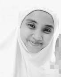 Farah Seila Mazlan photographed wearing a telekong, smiling.
