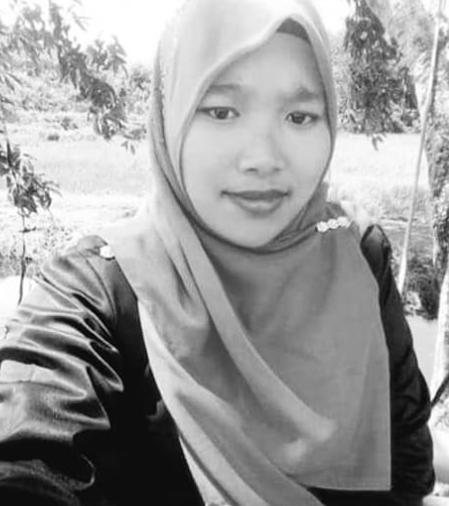 Nor Zailina binti Samad in a selfie. She wears a headscarf and is smiling slightly.