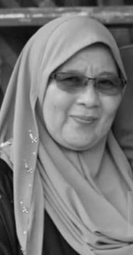Noor Asiah Ahmad, a middle-aged woman wearing a headscarf and tinted glasses.