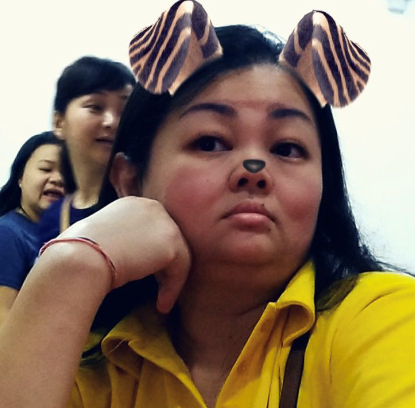 Toh Guat Ping poses with a social media filter of dog ears.