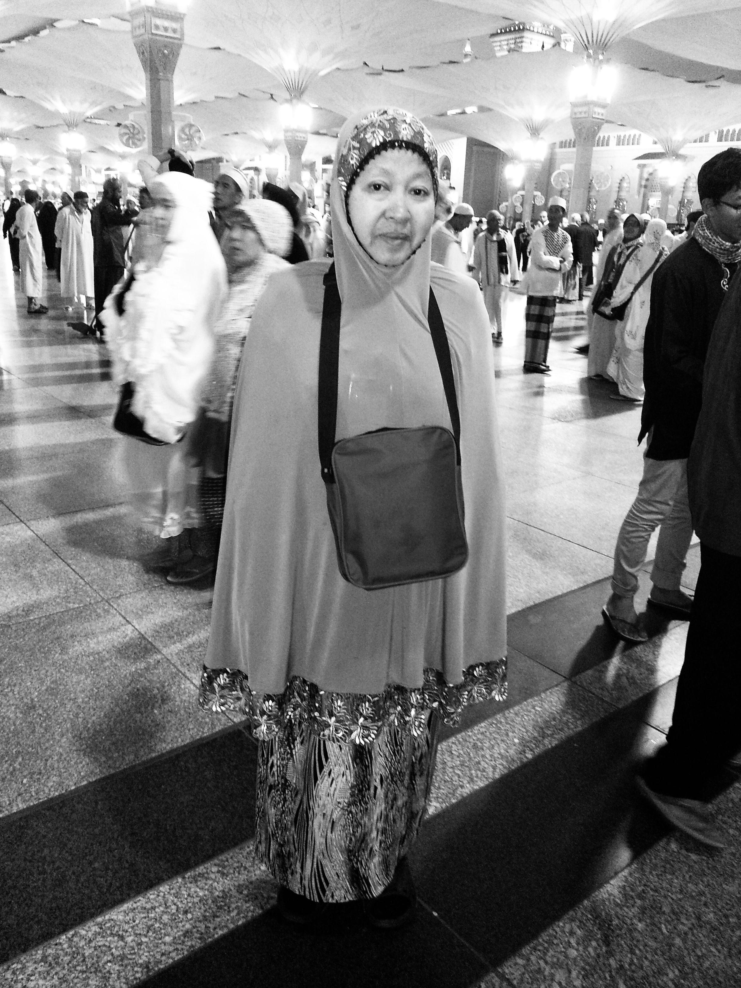 Che Aprah bt Hassan, 60, at Medina, Saudi Arabia. She is posing at Masjid An Nabawi, in a telekung and a sling bag.