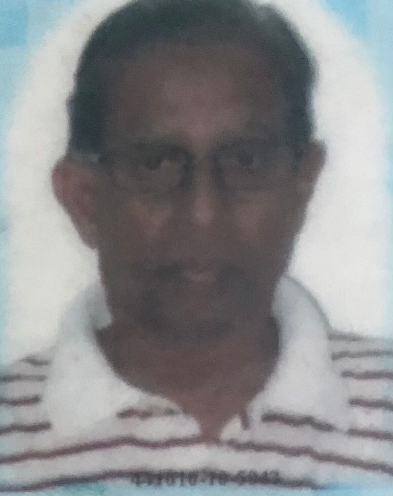 Syed Hassan Syed Ghafur, 76, in his identity card photo. He is tanned, with short hair. He is wearing glasses and a collared white T-shirt with red horizontal stripes.