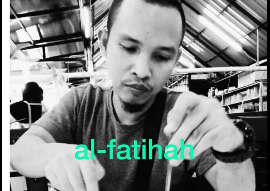 Suhaimi Bin Yahya in a candid shot. He is eating. He has a goatee and a mustache.