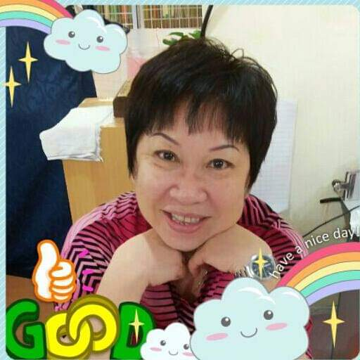 Lee Oi Mei is smiling widely. She has shot hair. A filter with rainbows frames the picture.
