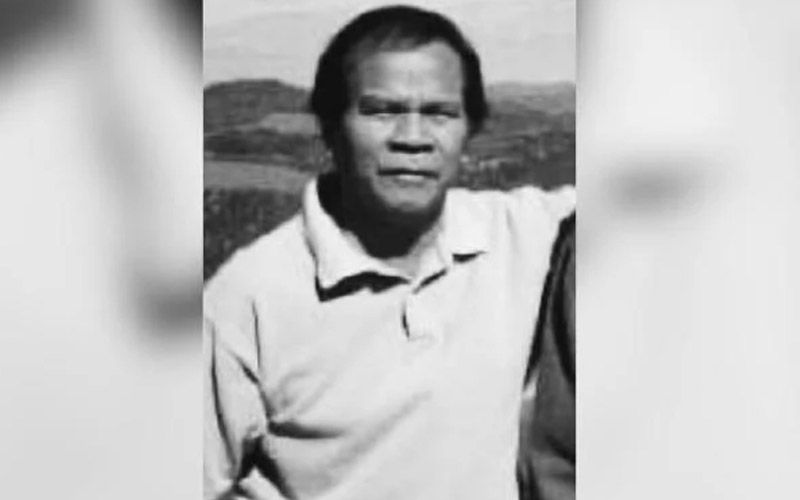 Mat Yusoff Ismail is pictured as a middle-aged man with hair on that is slightly longer on the sides. He is wearing a collared T shirt.