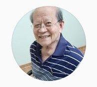 Toh Sea Choon wearing a blue stripe shirt with a huge grin