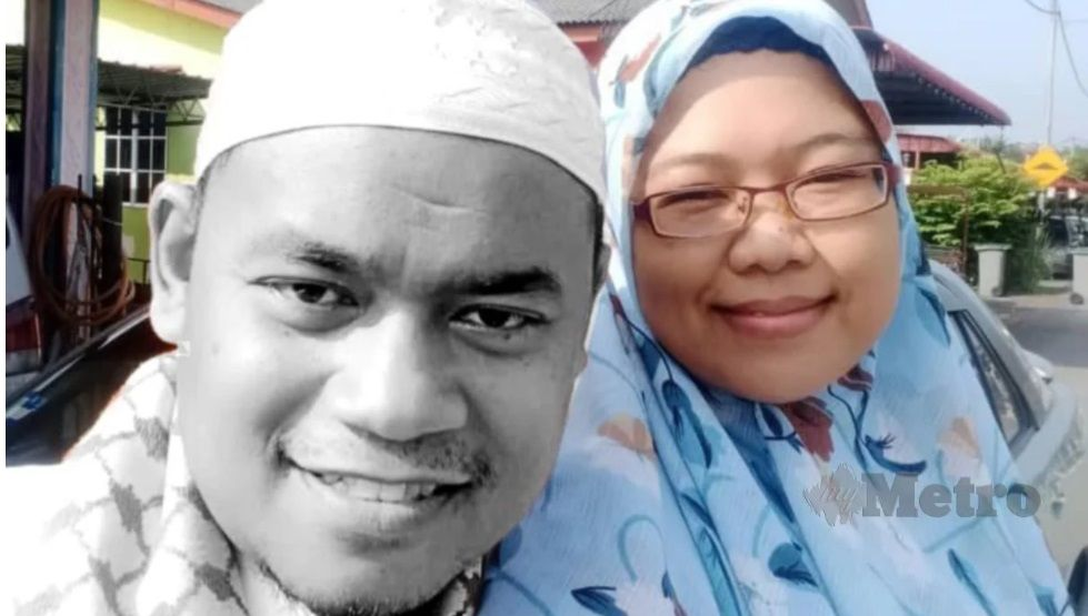 Hani Shaari with his wife. He is wearing a kopiah and has a scarf around his neck.