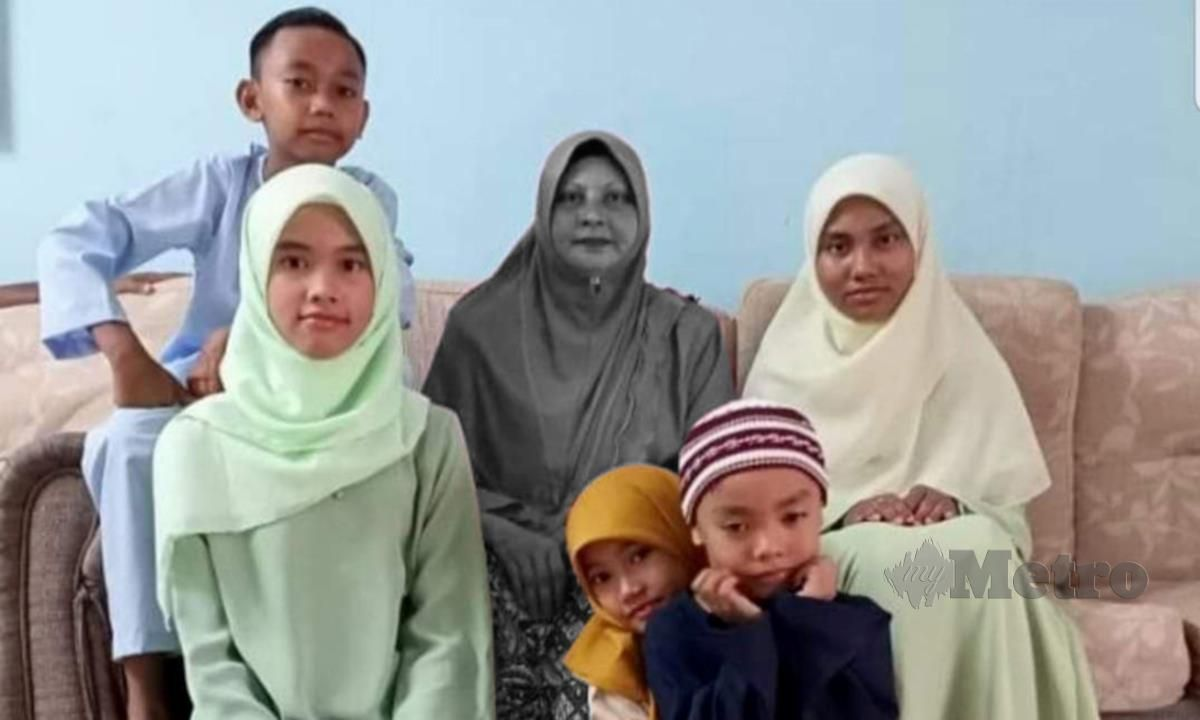 Taheran Md Isa with her five children.