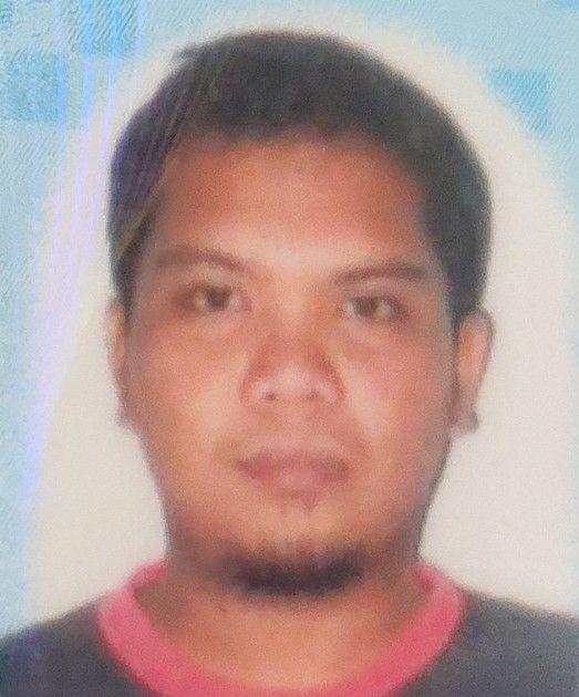 Identity card photo of Mohd Ridzuan bin Bakar, 37. He has short hair and a goatee.