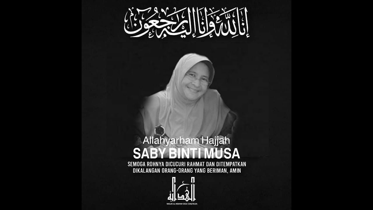 Condolence message for Saby Musa which shows Saby, a middle-aged woman, smiling, while wearing  headscarf and rimless glasses.