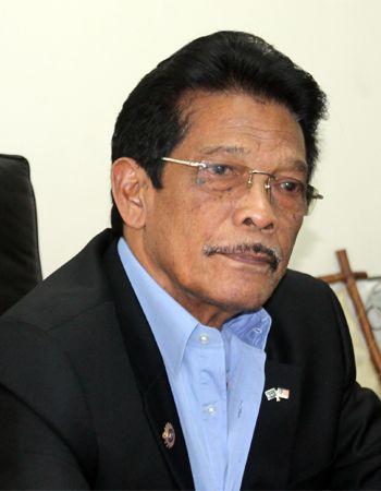 Dato Ghazi Ishak during a meeting.