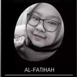 Najwa Nadhirah Zainudin in poses for a selfie. She is wearing a headscarf and dark rimmed glasses.