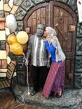 Salehuddin bin Hamid receives a kiss on the cheek from his daughter Mimi. He is holding helium baloons.